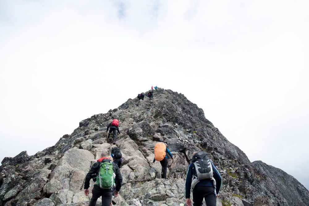 climbers hiking through mountain peak
